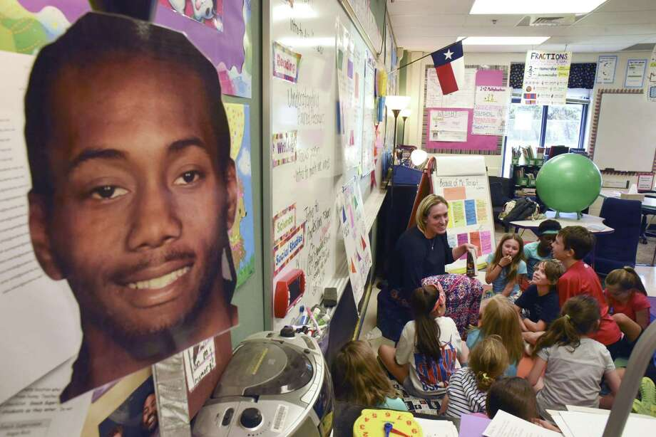 Blattman Elementary School fourth-grade teacher Erin Griffin conducts class by a cutout of the face of San Antonio Spurs basketball player Kawhi Leonard. Griffin is a fan of Spurs' small forward. She keeps a display of posters and figures featuring Leonard by the desk in her classroom. Griffin was an outstanding basketball player at St. Mary's University, where she averaged 15.6 points per game during her college career. Photo: Billy Calzada /San Antonio Express-News / San Antonio Express-News