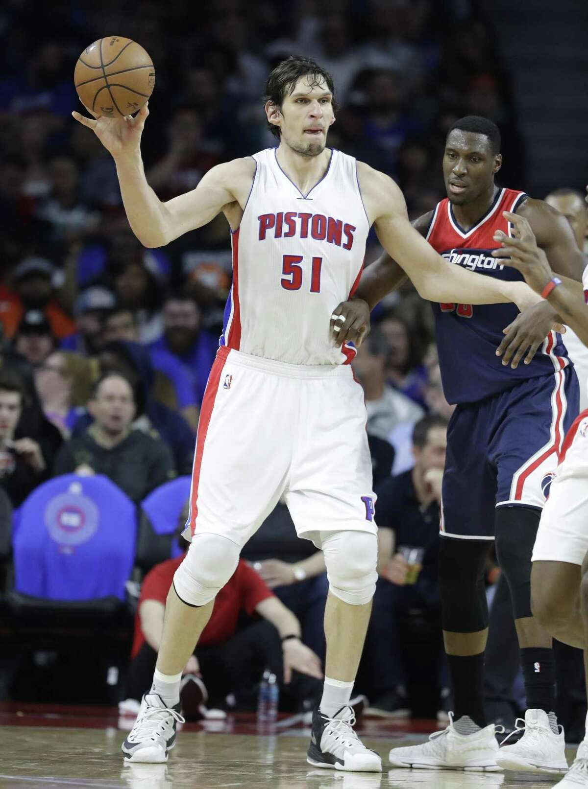 Detroit center Boban Marjanovic passes the ball during a game against the Washington Wizards on April 10 in Auburn Hills, Mich.