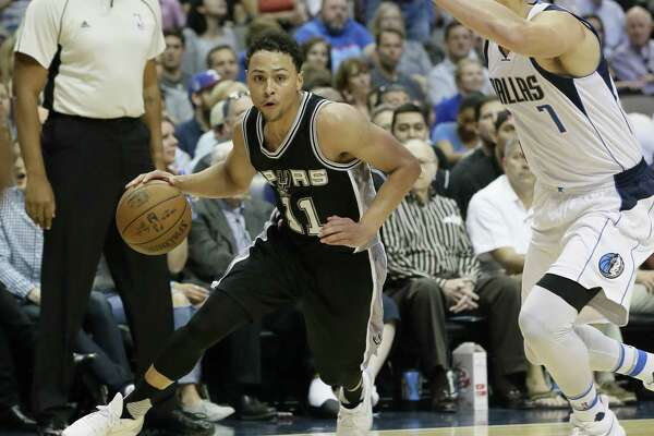 Spurs rookie guard Bryn Forbes works the perimeter against Dallas on April 7.
