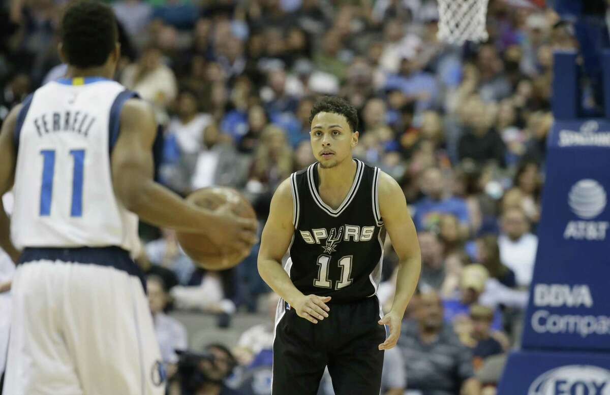 Bryn Forbes readies to defend against the Mavericks in Dallas at the end of the regualar season.