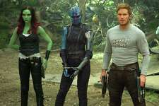 """This image released by Disney-Marvel shows Zoe Saldana, from left, Karen Gillan, Chris Pratt, Dave Bautista and Rocket, voiced by Bradley Cooper, in a scene from, """"Guardians Of The Galaxy Vol. 2."""" (Disney-Marvel via AP)"""