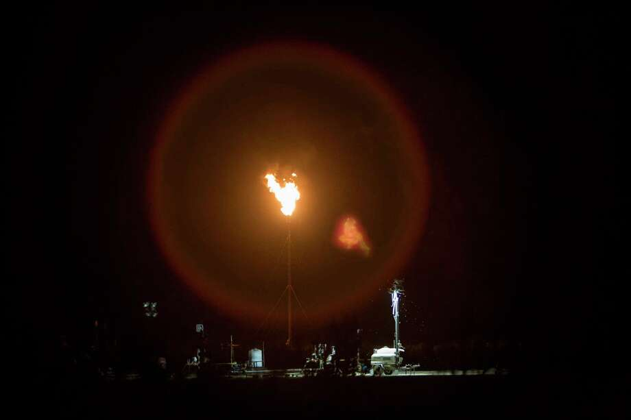 A flare is seen off I-10 near Balmorhea, Texas on March 27, 2017. Permian Basin producers burned off between 3 and 4 percent of their natural gas, higher than the state average, in 2014 and 2015, according to a report being released Tuesday by the Environmental Defense Fund. Photo: Carolyn Van Houten /San Antonio Express-News / 2017 San Antonio Express-News