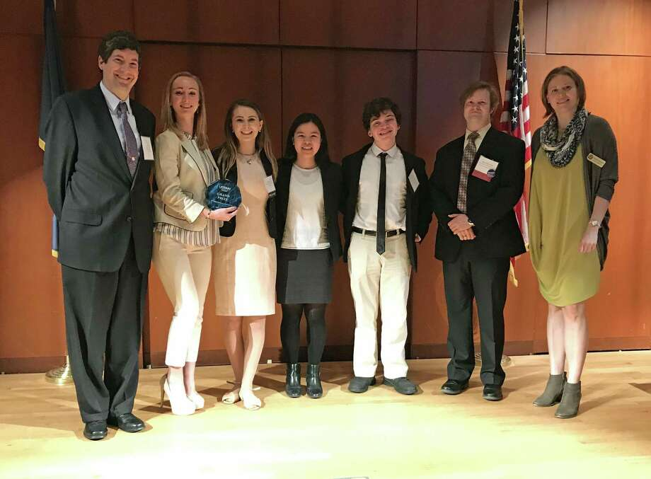 The Greenwich High Early College Experience Team collected the grand prize at the 2017 Globalization Conference at the University of Connecticut Storrs on April 17. (L to R) Coach of the ECE team Aaron Hull with juniors Lucy Mini, Valerie Cella, Michelle Xiong, Alexander Sklarz, UConn ECE Director Brian Boecherer and ECE Program Coordinator for Research and Development Magdalena Narozniak. Photo: Contributed