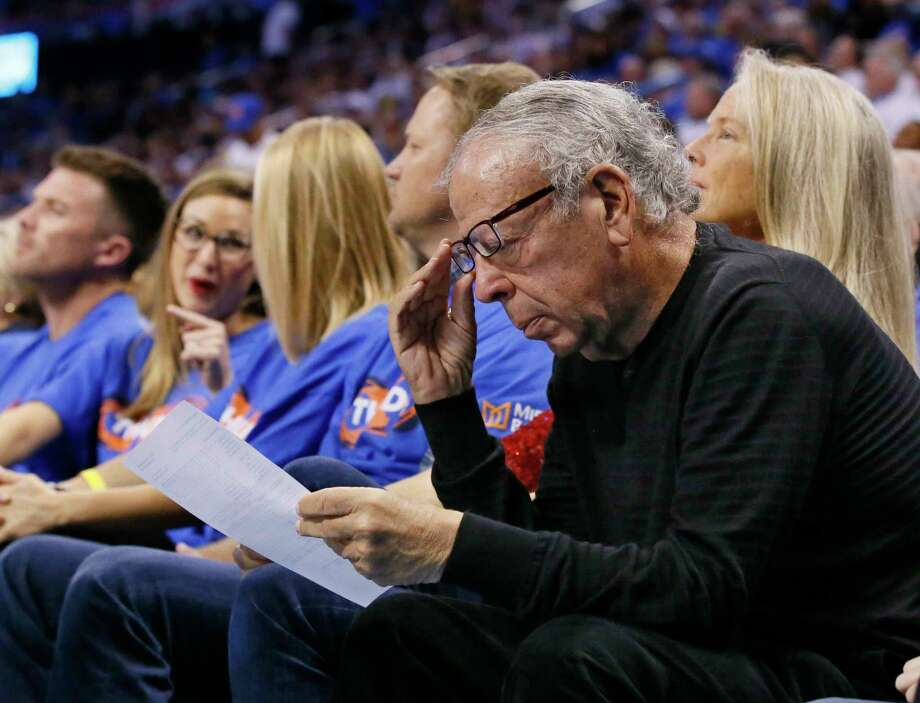 Leslie Alexander, owner of the Houston Rockets, looks over a stat sheet during the third quarter of the team's first-round NBA basketball playoff game against the Oklahoma City Thunder in Oklahoma City, Friday, April 21, 2017. Oklahoma City won 115-113. (AP Photo/Sue Ogrocki) Photo: Sue Ogrocki, Associated Press / AP2017