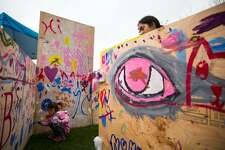Kids paint on the plywood mural at the Maker Faire on Jesup Green at the Westport Library in Westport, Conn. on Saturday April 22, 2017.
