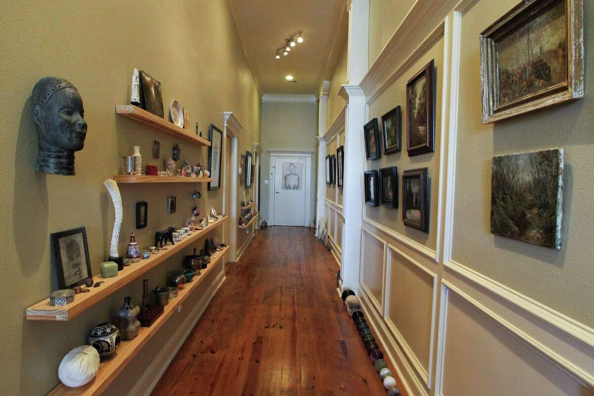 A long hallway serves as a showcase for Budelmann's art and artifacts.
