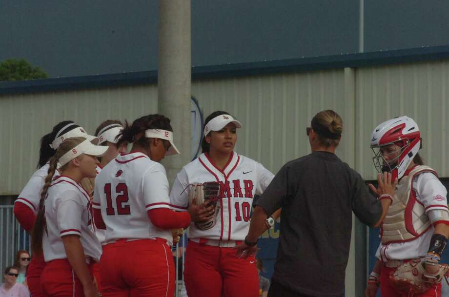 Lamar softball coach Holly Bruder gives instruction during the first inning of the Lady Cardinals' game against McNeese State on Saturday at Cowgirl Field in Lake Charles. Photo: Danny Shapiro