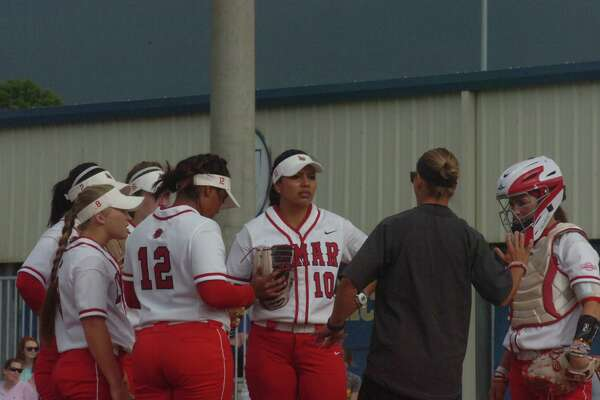 Lamar softball coach Holly Bruder gives instruction during the first inning of the Lady Cardinals' game against McNeese State on Saturday at Cowgirl Field in Lake Charles.