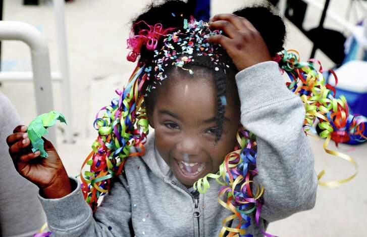 Mariah Smith ,4, enjoys giving herself a cascarones at the annual Taste of New Orleans at the Sunken Garden.  This two-day Fiesta event organized by the San Antonio Zulu Association celebrates all things cajun, from food to music on Saturday, April 22, 2017.