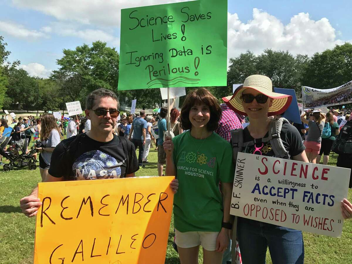 Scientists and supporters marched in Houston and across the nation on Saturday to protest federal cuts in research funds.