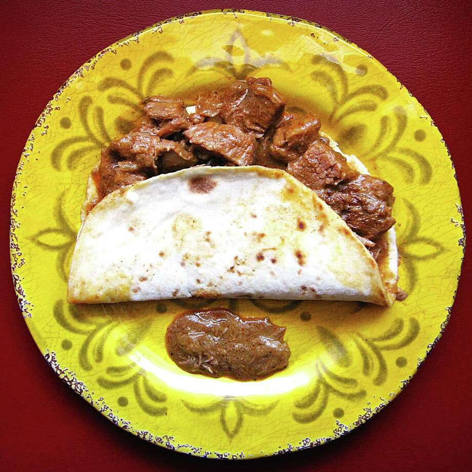 Carne guisada taco on a handmade flour tortilla from Norma's Place. Photo: Mike Sutter /San Antonio Express-News