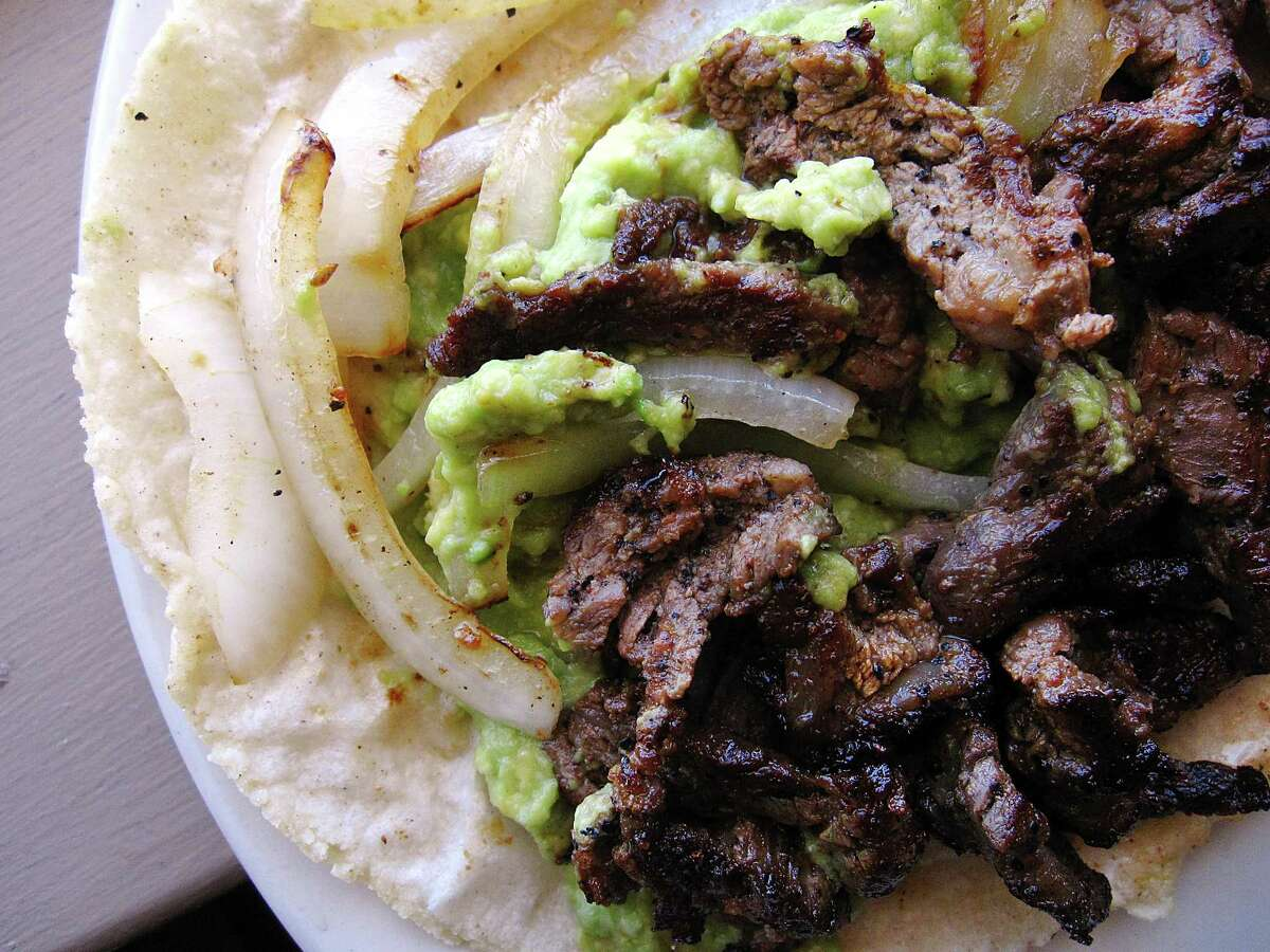 Beef fajita taco with guacamole on a handmade corn tortilla from Norma's Place.