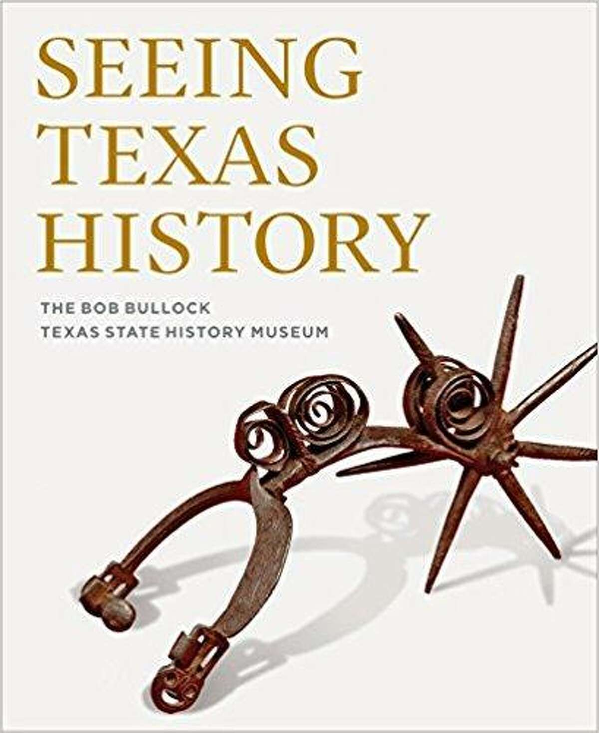 """A hand-forged iron espuela grande (great spur) was on loan to the Bullock Texas State History Museum and used for the 2016 cover of the museum's """"Seeing Texas History book. The spur, believed to be from the Spanish conquistador era, was returned to the Witte in 2012."""