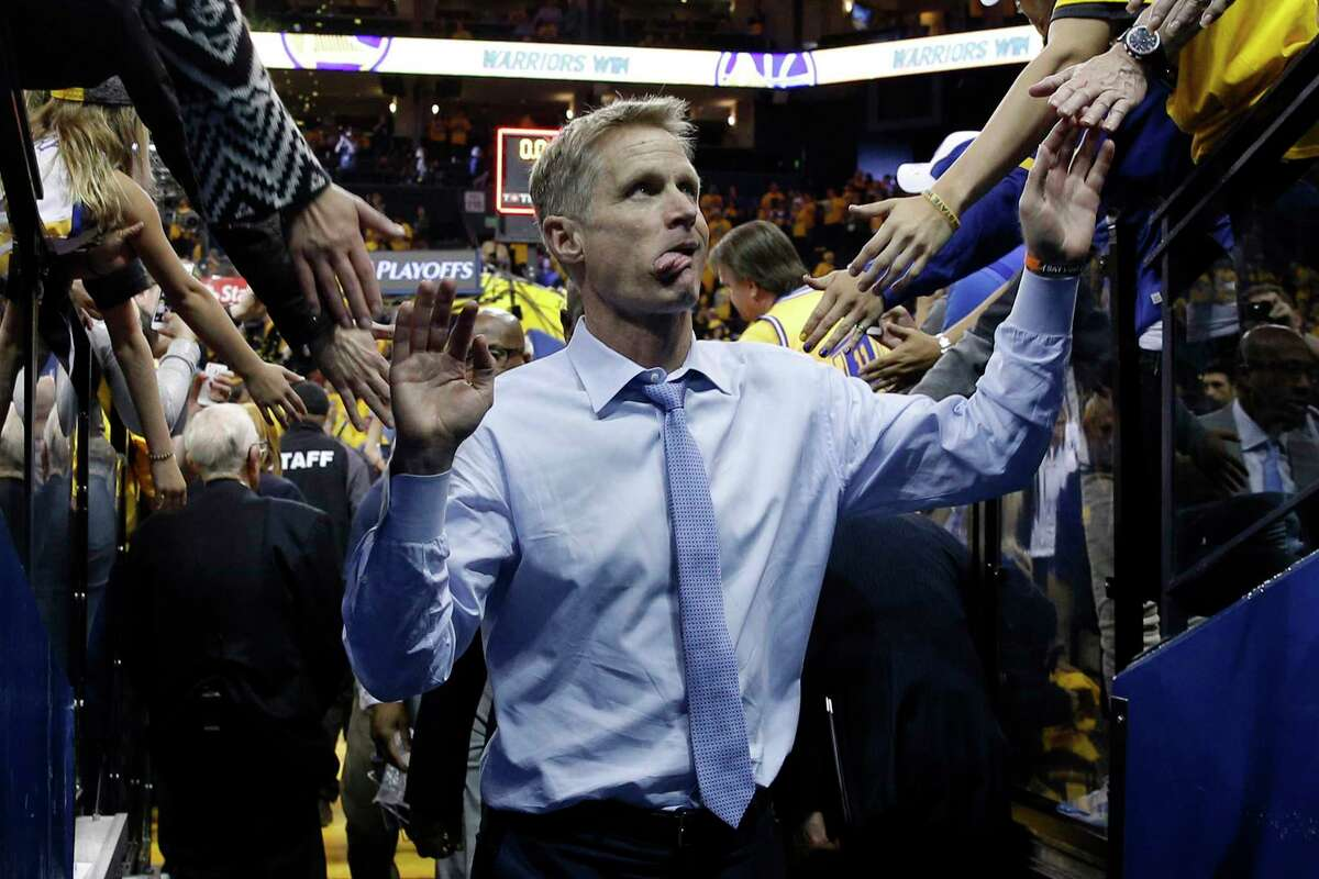 Golden State Warriors head coach Steve Kerr sticks his tongue out as he greets fans following the end of the NBA playoffs, Round 1, Game 2, between the Golden State Warriors and Portland Trail Blazers on Wednesday, April 19, 2017, at Oracle Arena in Oakland, Calif. Warriors won 110-81.