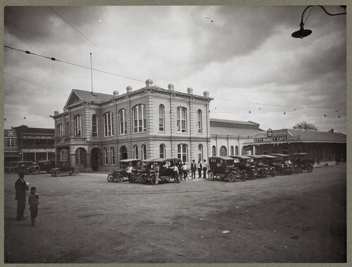The '20s: A City market with cars parked on the square in downtown Laredo.