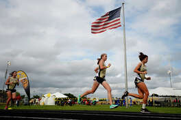Girls compete in the 3200 meter race at the District 22-5A championship track meet at Nederland's Bulldog Stadium on Monday.  Photo taken Monday 4/10/17 Ryan Pelham/The Enterprise