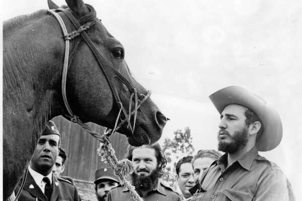 FIDEL CASTRO ON JOHN FERGUSON'S BAR JF RANCH NEAR WHARTON, TEXAS,  APRIL 28, 1959. HORSE IS NAMED KING CHAMP