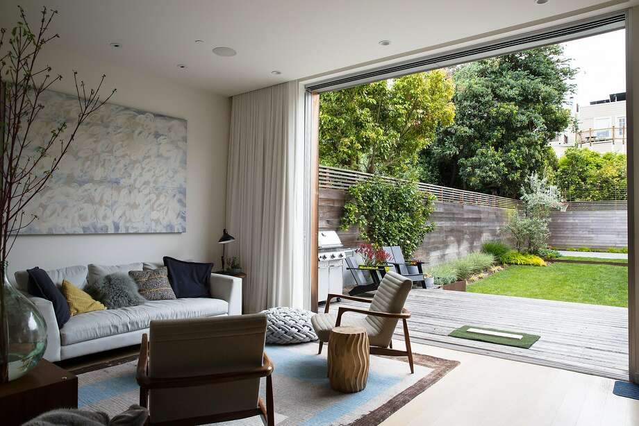 Living room of Nicole Rimpel and Lane Foard's home opens onto the backyard. Photo: Mason Trinca, Special To The Chronicle