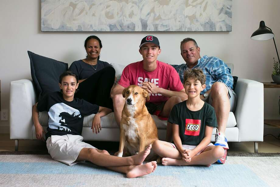 The family, from left, on the couch: Nicole Rimpel, Cooper Foard, 16, Lane Foard. In front, from left: Riley Foard, 13, their dog, and Jake Foard, 8. Photo: Mason Trinca, Special To The Chronicle