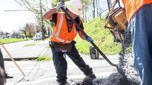 SDOT crews fill potholes at Beacon Ave S and S Orcas St. on Wednesday, April 19, 2017.