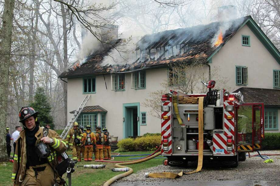 A house was heavily damaged by flames on Monday, April 24, 2017, on Old Highway in Wilton, Conn. Photo: Thane Grauel / Hearst Connecticut Media / Connecticut Post