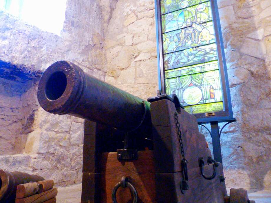 A historic cannon that was dedicated at The Alamo on Jan. 24, 2015, is positioned in a side room within the shrine. The San Jacinto Battleground Conservancy hosted a dedication for the Alamo Defenders' cannon, which was bought by a family in an auction and donated in 2008 to the conservancy, which restored it and loaned it to the Alamo. It hasn't concretely been proven, but experts believe the cannon was one of the 21 used to defend the Alamo during the historic battle of 1836. Photo: Billy Calzada /San Antonio Express-News / San Antonio Express-News