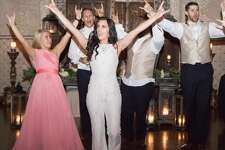 Natalie and David Grun were high school sweethearts before they both moved from their hometown in Humble to Austin to attend and cheer for the University of Texas. The Longhorn lovebirds tied the knot on April 8 in Conroe. They had the support — and stunts — of their fellow cheer alumni to root for their new husband-wife team.