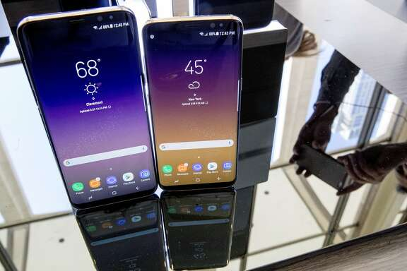 FILE - In this Wednesday, March 29, 2017, file photo, the Samsung Galaxy S8, right, and S8 Plus appear on display after a news conference, in New York. SquareTrade, a company that sells gadget-repair plans, says Samsung's latest phones, the Galaxy S8 and S8 Plus, are more prone to damage than earlier models due to their larger displays and high amount of glass. (AP Photo/Mary Altaffer, File)