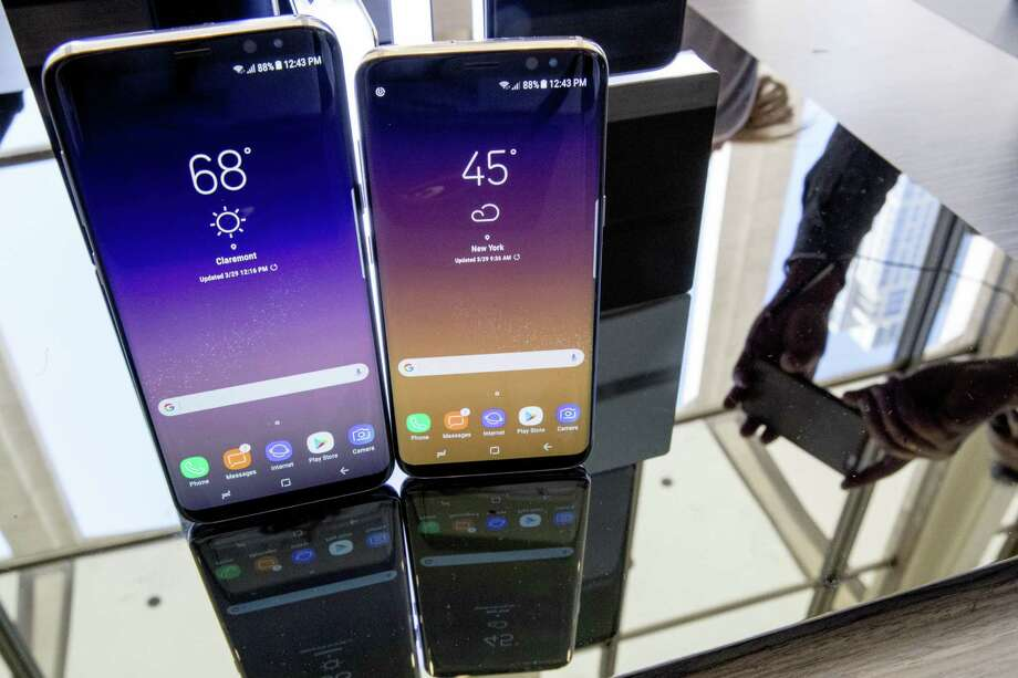 The Samsung Galaxy S8 (right) and S8 Plus appear on display. Photo: Mary Altaffer /Associated Press / Copyright 2017 The Associated Press. All rights reserved.
