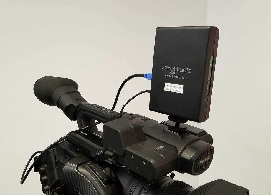 Shown is a CameraLink wireless adaptor atop a video camera. The adapter transmits to a wireless hub called a SlingStudio. Dish's wireless device SlingStudio is meant to enable multicamera productions without fancy equipment. Photo: Anick Jesdanun /Associated Press / AP