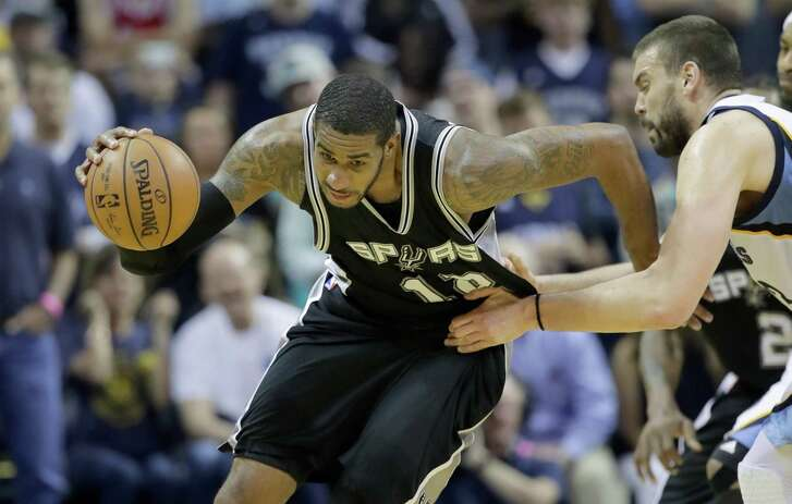 LaMarcus Aldridge of theSpurs grabs a loose ball against the Grizzlies in Game 4 at FedEx Forum on April 22, 2017 in Memphis, Tenn.