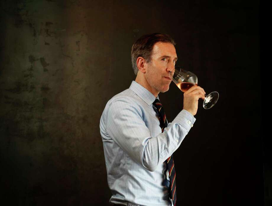 Sommelier Alex Fox with a glass of Peregrine Rose wine at The Pass and Provisions, Tuesday, April 18, 2017, in Houston. ( Karen Warren / Houston Chronicle ) Photo: Karen Warren, Staff Photographer / 2017 Houston Chronicle