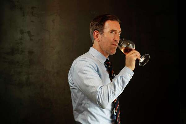 Sommelier Alex Fox with a glass of Peregrine Rose wine at The Pass and Provisions, Tuesday, April 18, 2017, in Houston. ( Karen Warren / Houston Chronicle )
