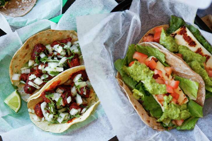 Tacodeli's tacos are garnished with produce that comes from local farmers.