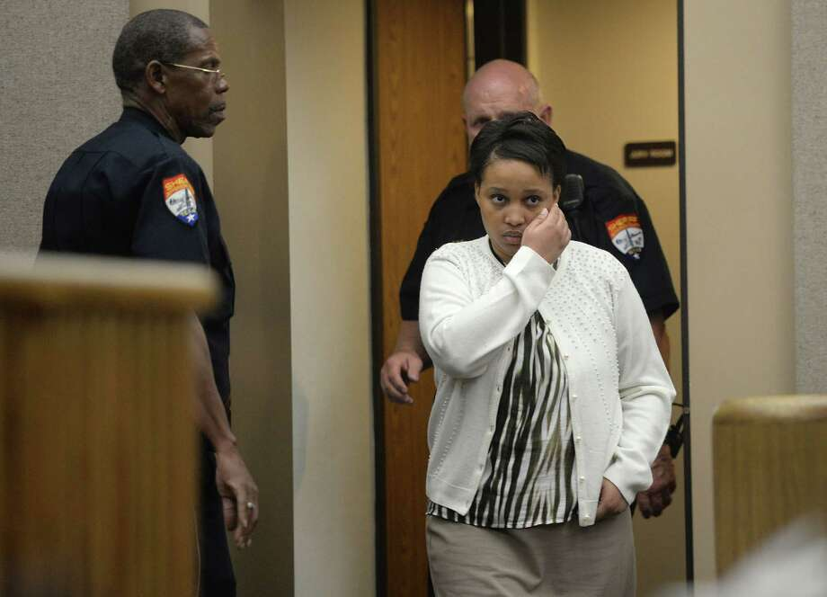Christine Johnson, mother of 'Baby' Faith Mason, enters the Jefferson County courtroom Monday afternoon before receiving a 20 year sentence and a 65 year sentence.