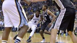 Grizzlies forward James Ennis (8) drives against Spurs forward Kawhi Leonard (2) during the first half of Game 4 on April 22, 2017, in Memphis, Tenn.