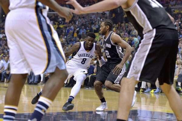 Grizzlies forward James Ennis (8) drives against Spurs forward Kawhi Leonard (2) during the first half of Game 4 on April 22, 2017, in Memphis, Tenn.