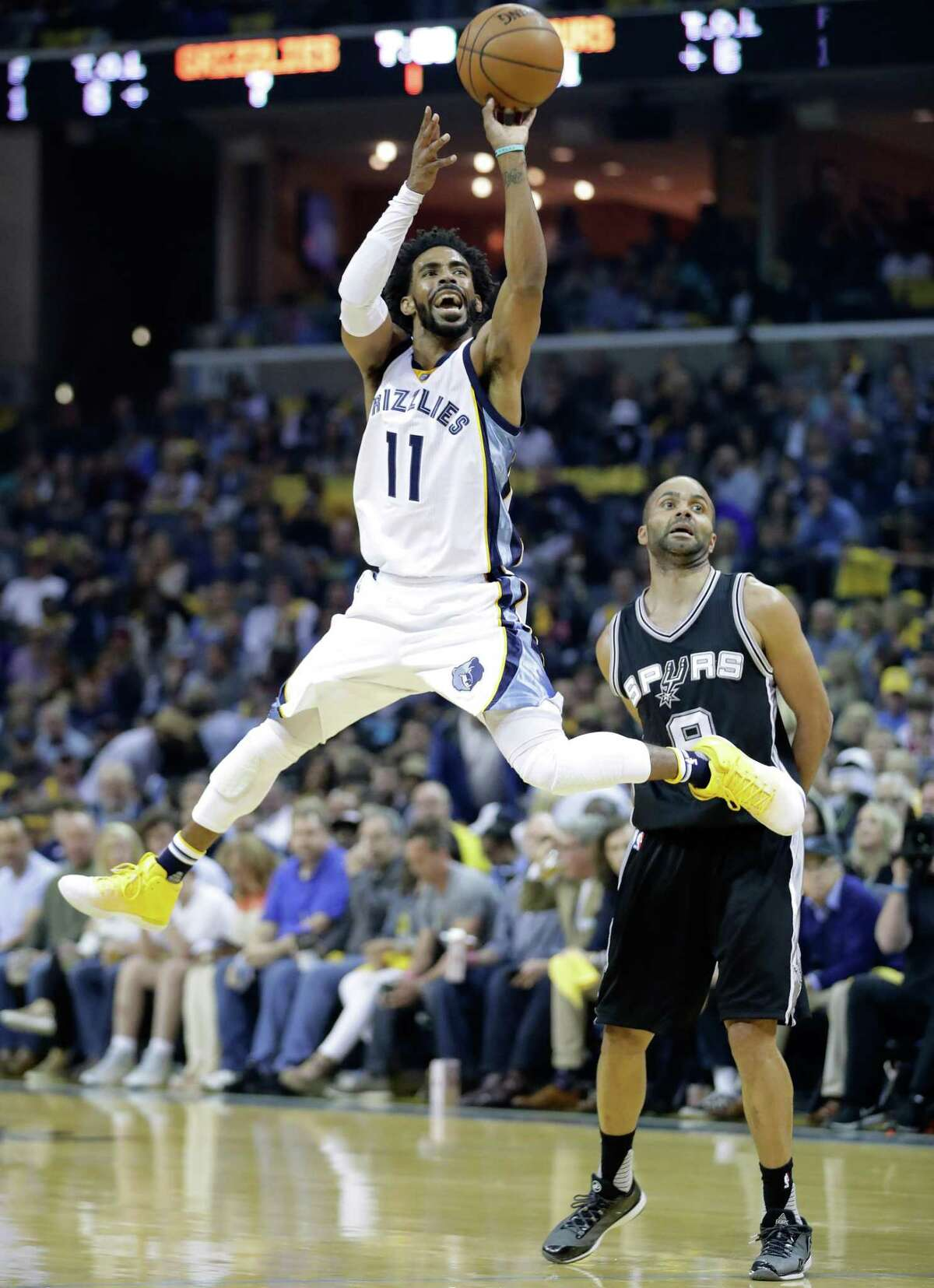 Mike Conley of the Grizzlies shoots the ball against the Spurs' Tony Park in Game 4of the Western Conference quarterfinals at FedEx Forum on April 22, 2017 in Memphis, Tenn.