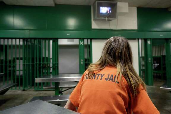 A female inmate sits in a single cell in an acute unit of the mental heath unit at the Harris County Jail in Houston. (AP Photo/Eric Gay)