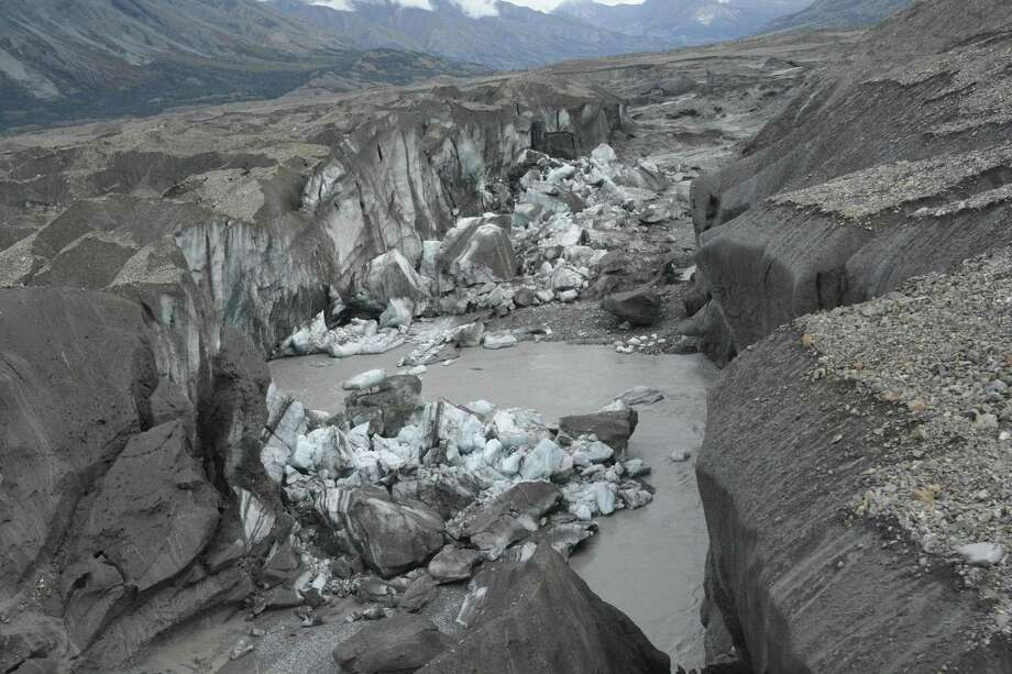 the ice-walled canyon at the terminus of the Kaskawulsh Glacier, with recently collapsed ice blocks. In the blink of a geological eye, climate change has helped reverse the flow of water melting from the glacier in Canadas Yukon, a hijacking that scientists call river piracy. Photo: JIM BEST /UNIVERSITY OF ILLINOIS /NYT / JIM BEST/UNIVERSITY OF ILLINOIS