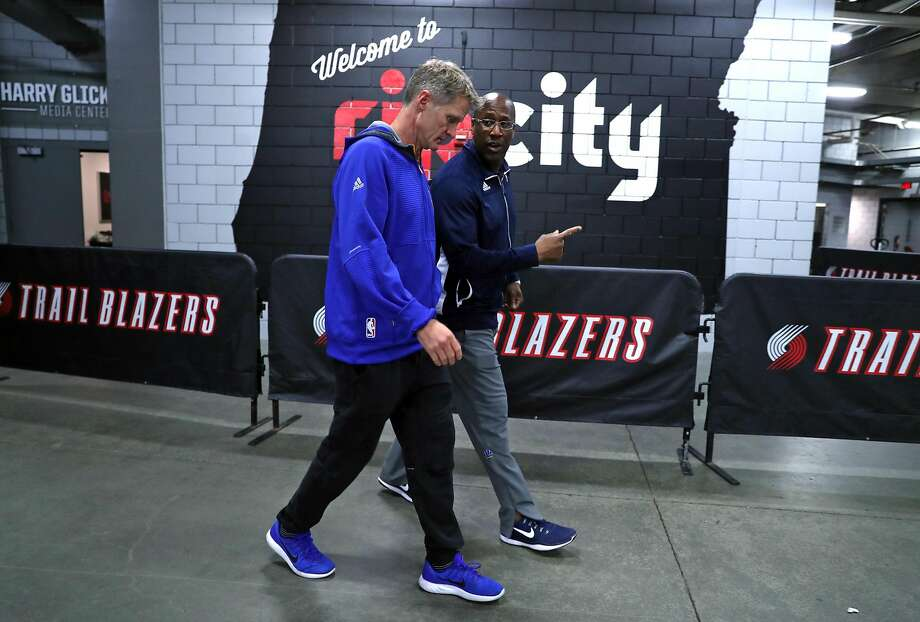 Warriors   coach Steve Kerr and interim coach Mike Brown head to the team bus after a shootaround before Monday's Game 4. Photo: Scott Strazzante, The Chronicle
