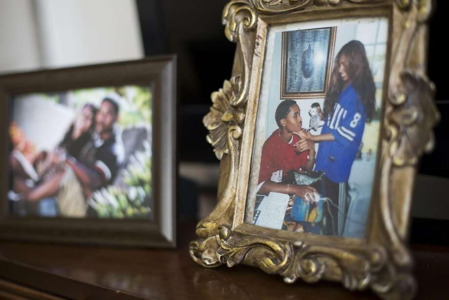 Family photos of Zecole Thomas and her late husband are on display in the Cary, N.C., home where Zecole and their sons moved after the suicide, fleeing California's high cost of living. Photo: Eamon Queeney, Special To The Chronicle