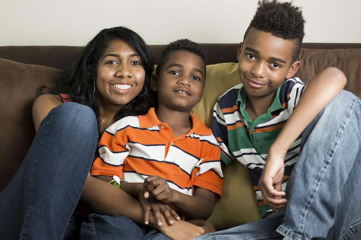 Zecole Wilkinson Thomas poses for a photograph with her boys Ezekiel, 7, center, and Joseph, 9, right, at their Cary, N.C., home, Saturday, April 15, 2017. Zecole's husband, Joseph Thomas, took his own life last year after less than 5 months of working as a software engineer at Uber in California. With the company refusing workers' comp benefits and her boys still coming to terms with a missing father, Zecole and her children have started a new life in North Carolina. (Eamon Queeney Special to The Chronicle)