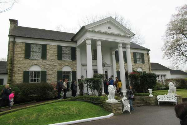 This March 13 photo shows visitors getting ready to tour Graceland in Memphis, Tenn. Elvis Presley bought the mansion — which is small by 21st century standards — in 1957 and lived there until his death 20 years later.