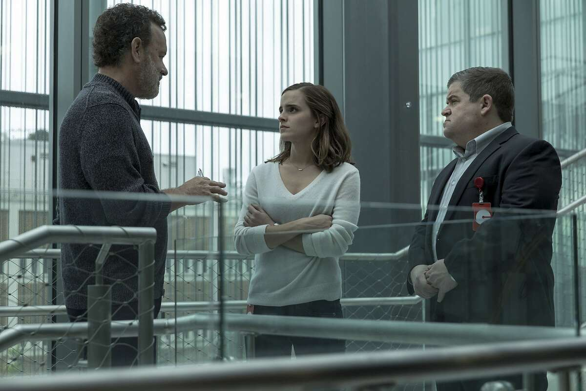 """This image released by STX Entertainment shows Tom Hanks, Emma Watson and Patton Oswalt in a scene from """"The Circle."""" (Francois Duhamel/ STX Financing via AP)"""