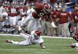 FILE -  This Jan. 2, 2014, file photo shows Alabama linebacker Reuben Foster (9) hitting Oklahoma running back Roy Finch (22), resulting in an incomplete pass during the first half of the Sugar Bowl NCAA college football game in New Orleans. Vicious hitter who is probably too light to play middle linebacker in the NFL. Top-10 talent who might slip a bit because the value of linebackers who are not edge rushers is down in the NFL. He also was dismissed from NFL combine for argument with hospital worker. (AP Photo/Rusty Costanza, File)
