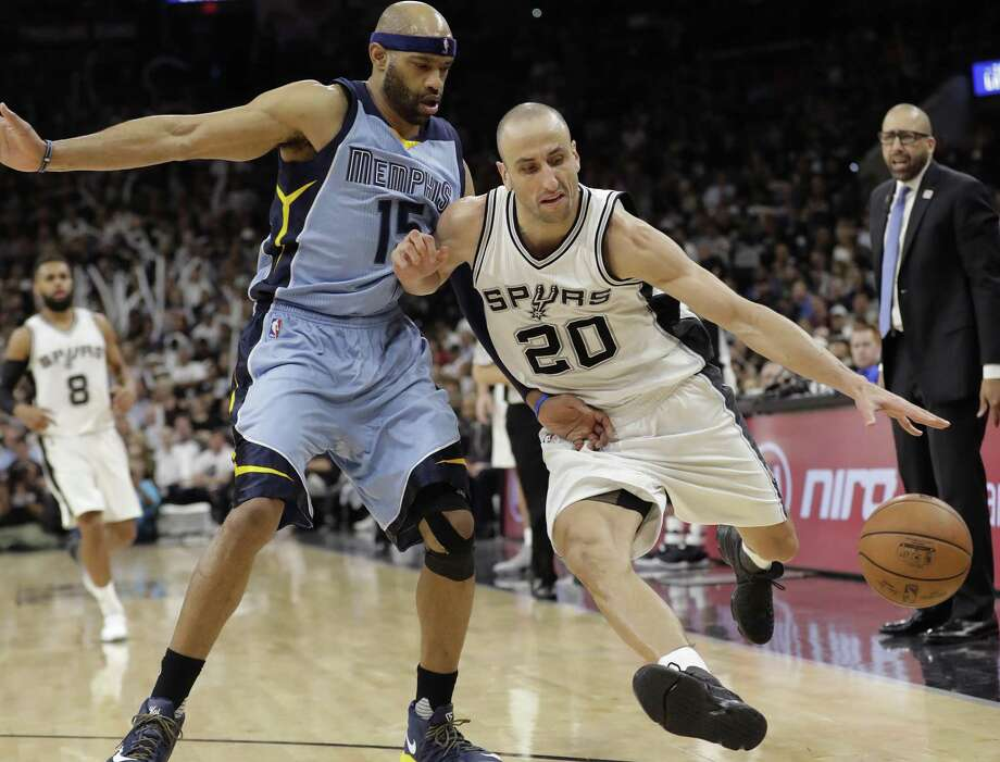 Spurs guard Manu Ginobili (20) drives around Memphis Grizzlies guard Vince Carter (15) during the second half in Game 2 of a first-round playoff series on April 17, 2017, in San Antonio. Photo: Eric Gay /Associated Press / Copyright 2017 The Associated Press. All rights reserved.