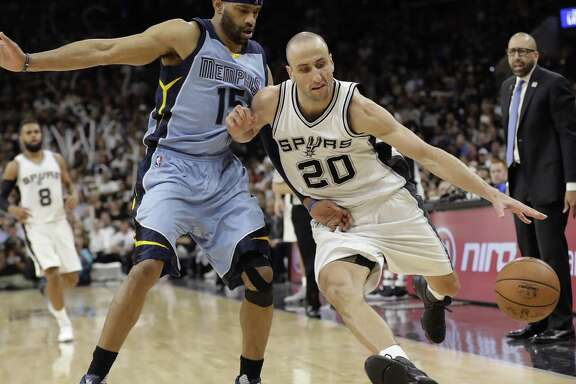 Spurs guard Manu Ginobili (20) drives around Memphis Grizzlies guard Vince Carter (15) during the second half in Game 2 of a first-round playoff series on April 17, 2017, in San Antonio.