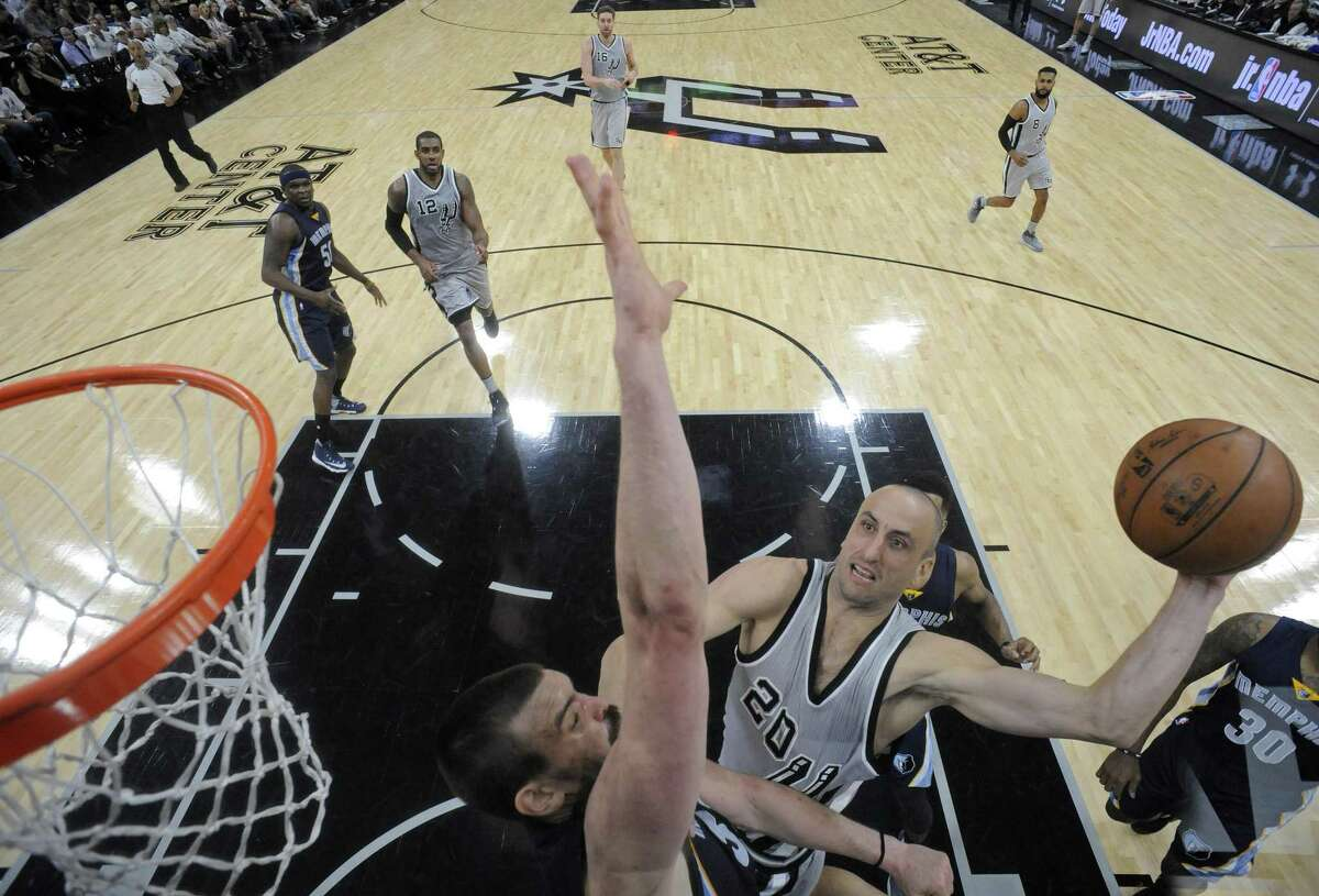 Spurs' Manu Ginobili shoots against the Memphis Grizzlies' Marc Gasol during Game 1 in the first round of the Western Conference playoffs on April 15, 2017 at the AT&T Center.