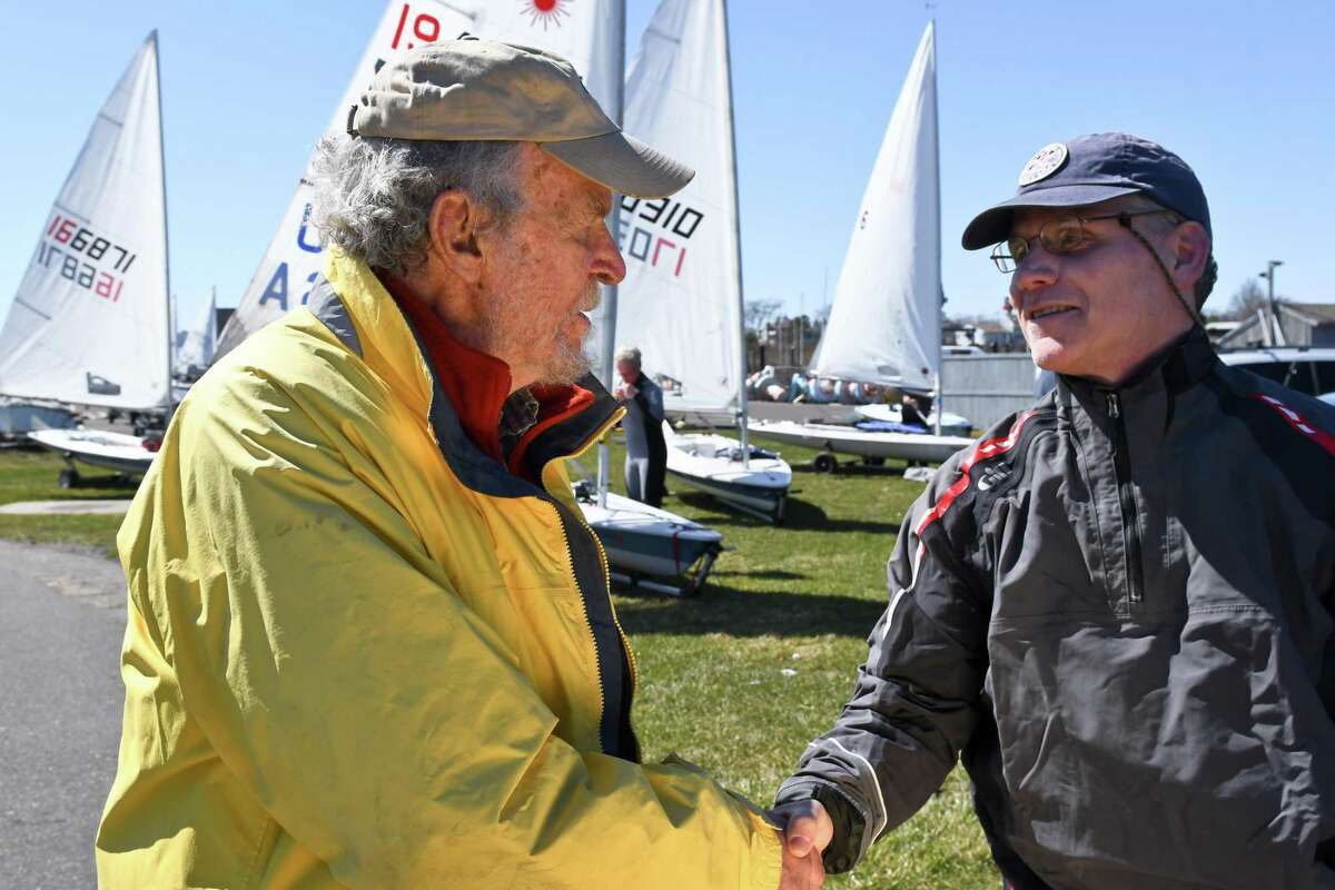 Racing sailboat designer Bruce Kirby, 88, talked with some of his admirers at a recent regatta of his Laser series boats at the Cedar Point Yacht Club in Westport.
